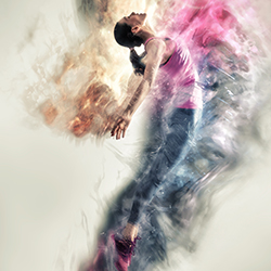 woman jumping in air with colors swirling around her
