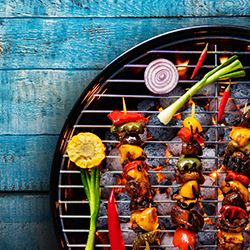 bbq grill on blue wood background